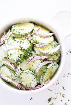 German Cucumber Salad - Crunchy cucumbers in a creamy, tangy sour cream dressing. So easy and so delicious! Potluck Recipes, Healthy Salad Recipes, Cooking Recipes, Vegetarian Recipes, Cucumber Recipes, Vegetable Recipes, Potluck Ideas, Weeknight Recipes, Potluck Dishes