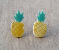 Those are fun pineapple earrings. The materials are brass hooks, and handmade glazed ceramic.    This item is ready to ship now! Please dont