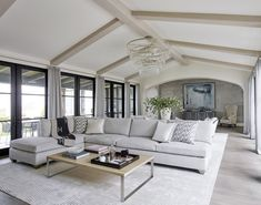 A standout living room includes acustom chandelier made by Zia Priven and rug by Tamarian. Family Room, Home And Family, Modern Interior, Interior Design, Cabins And Cottages, French Country House, Modern Farmhouse Style, White Rooms, New Living Room