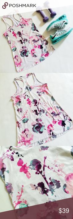 """▪️ SALE ▪️ Lululemon Blurred Blossom Top Lululemon Blurred Blossom Every Yogi Top in bright floral design featuring lightweight moisture-wicking material.  Pre-loved but in excellent condition.  No holes, stains or tears.  No size tag, fits like a Medium.  Please verify measurements to ensure correct fit. ▪️ SALE! $39 marked down to $36!▪️  Measurements laying flat: Armpit to armpit: 15.5""""  Waist (across): 15""""  Total length: 27"""" (approx.) lululemon athletica Tops"""