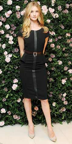 At the launch of her new Marks & Spencer lingerie line Rosie for Autograph, Victoria's Secret model and actress Rosie Huntington-Whiteley wowed in a stunning black peplum dress with a front leather panel. She paired it with a chic burgundy belt, gorgeous flowing waves, cute cap-toe heels and barely-there makeup.