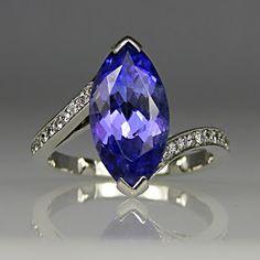 Hello there, pretty. Beautiful Tanzanite and Diamond Ring