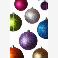 All That Glitters  Glitter has come a long way since the kindergarten crafts of youth. Ornaments with this sparkly finish simply shout fun. If you can't find any, grab some old ornaments, spread some glue and tap into your inner child, as you cover them (and everything else) in fabulous glitter.