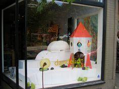 Love the thought of using the carboard play for window displays.  Simple and cute.