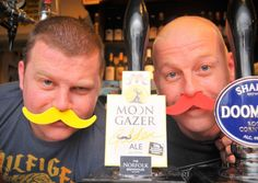 Brothers Nick ( red Tache ) and David Hubbard at the Surrey Tavern sporting a foam upper lip for Movember. Pictured next to the Moon Gazer pump that 20p from each pint is going to the charity.Photo: Steve Adams