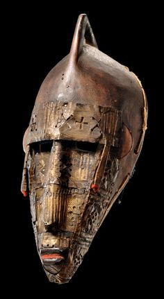 Africa | Mask from the Marka people of Mali | Wood, punched copper sheet and fiber