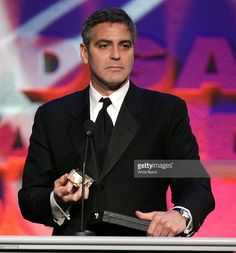 Director George Clooney accepts the nomination plaque onstage during the 58th Annual Directors Guild Of America Awards held at Hyatt Regency Century Plaza on January 28, 2006 in Los Angeles, California. EXCLUSIVE.