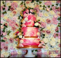Pink watercolour effect buttercream Wedding cake with Macarons, decorated with peonies, hydrangeas and roses