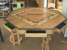 Monopoly table idea for the man cave.i would do a side risk game and the other one for the monopoly game in order to save space. Wooden Board Games, Board Game Table, Wood Games, Table Games, Modern Game Tables, Modern Games, Woodworking Plans, Woodworking Projects, Woodworking Classes