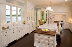 Great kitchen, but look at that view blocked by cabinets... why have such a great view if you only put in one smallish window?