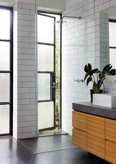 white subway tile + slate + wood + floating cabinetry