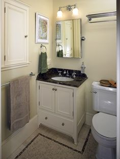simple small white vanity. I like the mirror too