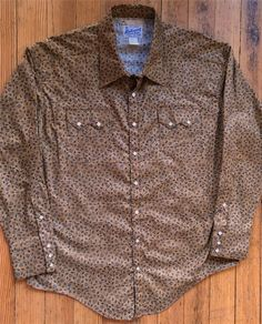 The original maker of the snap front western shirt. Western wear includes vintage embroidered shirts, bolo ties, hats and boots. Westerns, John Denver, Cowboys Shirt, Western Shirts, Images, Floral Prints, Shirt Dress, Usa, How To Make