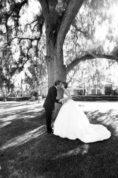 A beautiful wedding photo at The Beverly Hills Hotel. We love the bride's full skirt.