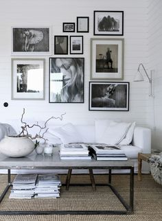 natural hues in a Scandinavian style living room, random picture wall layout