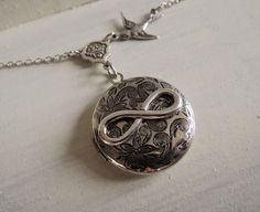 Lockets – Infinity Locket antique silver necklaces jewellery – a unique product by MadamebutterflyMeagan on DaWanda