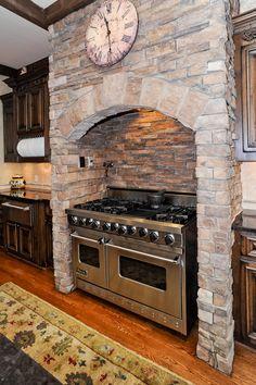 73 Avon Kitchen Cabinets I love the stone around the giant stove Kitchen Oven, Stone Kitchen, Kitchen Redo, Kitchen Pantry, Rustic Kitchen, Dark Kitchen Cabinets, New Kitchen, Kitchen Dining, Kitchen Remodel