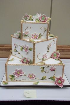 Offset Square Tiers Cake with flowers.  Very cool, I love the 2D/3D mix.