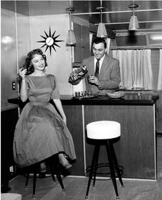"""Happy Hour, 1950s. A bar in the basement """"rumpus room"""" was the height of luxury."""