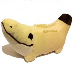 Product Attributes Primary Material: Minky Size: 5 inches tall x 10 inches long  Pattern: Croconana! Color: Yellow