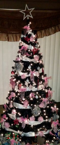 2016 pink tree. made the pinecone ornaments from our trees and paint. made the pink yarn ornaments from styrofoam balls and eyelash yarn. made the large silver ornaments from styrofoam balls and silver garland.