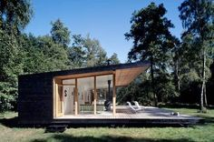 Very small and very cool. We found this summer home in Asserbo, Denmark through the Slow Home website. Designed by Christensen & Co Architects, it's essentially a glassed-in platform porch with a row of tiny rooms along the timber back wall. Inside, white walls and floors reflect light, and furnishings are minimal...
