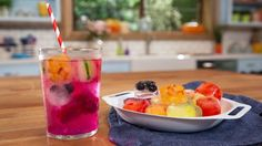 Recipe with video instructions: With fresh, colorful fruits like dragon fruit, kiwi, and blueberries, this gorgeous summertime drink is super refreshing. Ingredients: For the red: hulled strawberries, cut into small pieces, For the purple: champagne grapes, stems removed, For the hot pink/purple: dragon fruit, cut into small pieces, For the green: kiwi, cucumber, mint leaves, and/or lime wedges, cut into small pieces, For the yellow: lemon wedges and/or mango, cut into small pi...