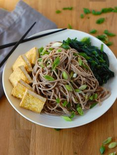A quick and easy recipe for vegan, gluten-free soba noodles with tofu and spicy sesame sauce.