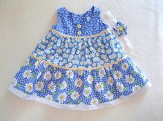 Baby girl tiered sundress with matching by ForTheLoveOfSmocking. $25.00 USD, via Etsy.