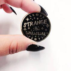 Strange and Unusual Enamel Pin