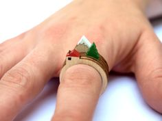 """Jewelry is essentially wearable art. But something that's more """"art"""" than """"jewelry"""" are these mini . Read more Mini Diorama Rings: Wearable Art For Your Digits Ringa Linga, Laser Cut Jewelry, Tree Rings, 3d Prints, Wooden Rings, Laser Cutting, Wearable Art, Ring Designs, Jewelry Accessories"""