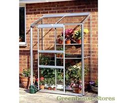 Halls 2ft x 4ft Wall Garden Lean to Greenhouse http://www.greenhousestores.co.uk/Halls-2x4-Wall-Garden-Lean-To-Greenhouse-Toughened-Safety-Glazing.htm