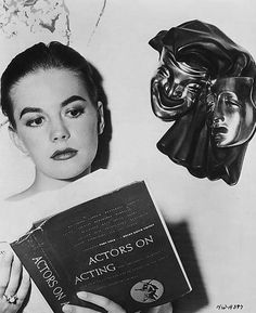 Natalie Wood /// My new little fixation on her--these photos of her with a book. Most often they are candids of her, and this one is painfully staged, but in all the rest the candid catches her nose down in a magazine or book. It cannot be said of candids of all our other actors and celebrities, I think--certainly not with selfies on the rise...AC