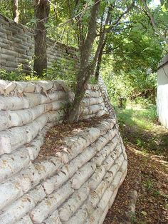 "Just stack up bags on concrete- leave them ""as is"" through a few big rains ir thoroughly soak a few times and then tear off paper - voila! a VERYsimple concrete bag retaining wall -with no work"