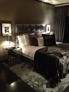 Master bedroom ideas. Dark bed. Black and white pillows. contemporary rug. silver nighstand. silver table lamps. For more inspirational ideas take a look at: www.bocadolobo.com