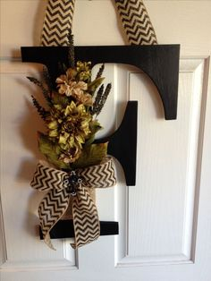 Front door letter F. Floral piece is blocking most of F. Hiding the F a little.