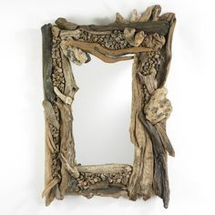 driftwood mirror: This reminds me of weekends at the beach when I was a kid, collecting driftwood. I'm inspired to make one. for my guest room.