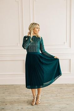 The Arabella Lace Dress is back and better than ever in these gorgeous fall colors! This one is a hunter green color and the lace top has a nude lining. Pleated bottom half and fully lined. Zips up in the back.              ...