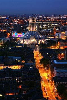 Liverpool Metropolitan Cathedral at one end of Hope Street Liverpool. The Philharmonic Hall is in the foreground.