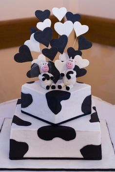 Love the hearts and cow print. Add 2s, round cake and hot pink? @Amanda Cunigan :)