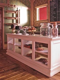 cute mini bakery (color, glass jars, cake pedestal, open shelving)