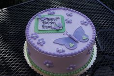Purple and green butterfly and daisy baby shower cake