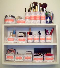 Makeup organization shelf. This is just a photo, but it looks like these are vases and candle cups or reused candle jars. I could use scrapbook paper or lace.