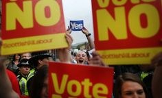 Yes campaigners stand near No supporters at Dumbarton Town Hall as former Prime Minister Gordon Brown leaves after attending a rally on Sept. 16, 2014 in Glasgow, Scotland. Peter Macdiarmid—Getty Images