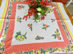 A gorgeous red and yellow cottage tablecloth. Find this on Etsy