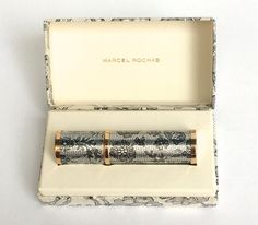 Marcel Rochas Femme atomizer Pursatomizer  This beautiful purse sized atomizer was created by Marcel Rochas of Paris in the 1960s and was named