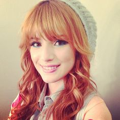 Cute! I love the way her bangs are styled with the curled hair... The hat is really cute, also!