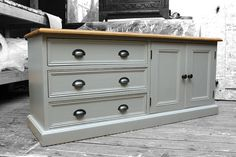 This solid pine cabinet has been refinished in Elephants breath Farrow & Ball and sealed with Polyvine matt varnish.  The door handles and drawers pulls are antique iron and are from the Cottingham collection.  The top has been stripped and finished in satin osmo oil.  Message me if you wish to commission a similar piece. Delivery nationwide available.  Please ask for any further details.