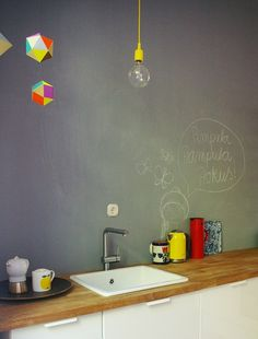 white + wood countertop + black board wall + pops of colours