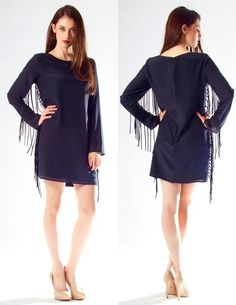 Long Sleeve Black Silk Fringe Mini Dress ($40) An elegant long sleeve mini dress with fabulous fringe flowing down the bodice and arms. Featuring a body-skimming silhouette, scoop neck and zip closure back. Simply add your favorite heels and a clutch for your next holiday party or black tie affair!   100% Silk Fully Lined Made in USA